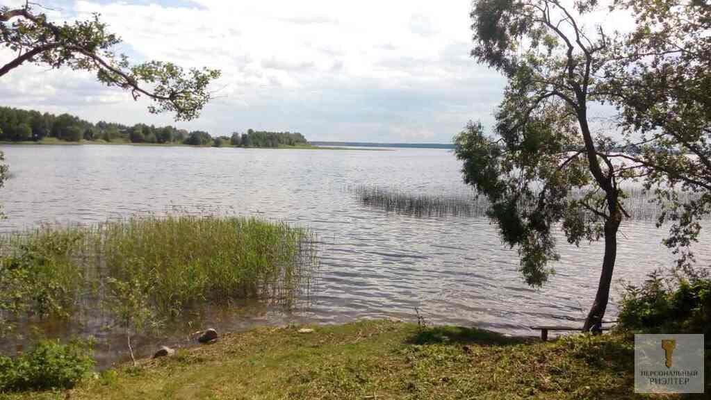 Участок на берегу озера - Фото 0